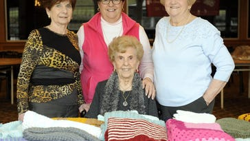Loving Hands and Hearts Knit and Crochet Group includes co-leaders Carmela Sgroi (seated) of Livonia, and Teresa Peruchietti (from left) of Dearborn Heights, group leader Connie Vassallo of Livonia, and member Shirley Bona of Farmington Hills.