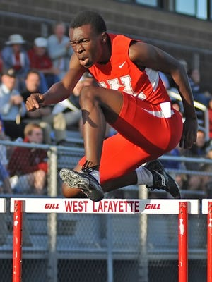 Red Devil senior Daniel Afolabi burns through the hurdles Thursday at the West Lafayette boys IHSAA sectionals.