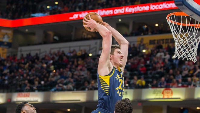 Pacers forward T.J. Leaf (22) goes to slam dunk the ball over Chicago Bulls forward Paul Zipser (16) in the second half of the game at Bankers Life Fieldhouse.