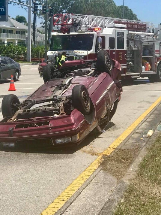 Five people were involved in a crash that left one car overturned in Fort Pierce.