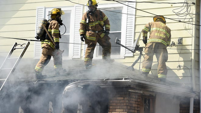 Erie firefighters battle a blaze at a West 21st Street home in March.