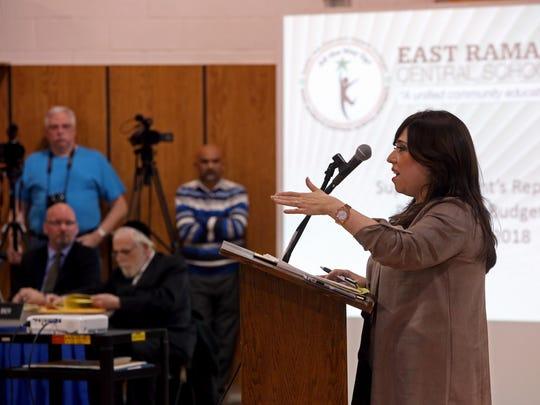Rivkie Feiner of Monsey speaks at an East Rampo School