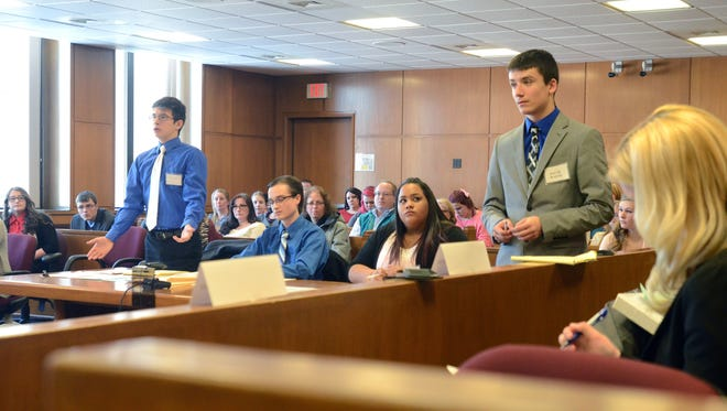 Marine City team member Alejandro Menchaca objects to a question by Memphis' Jacob Walsh Saturday during the Mock Trial competition at the St. Clair County Courthouse.