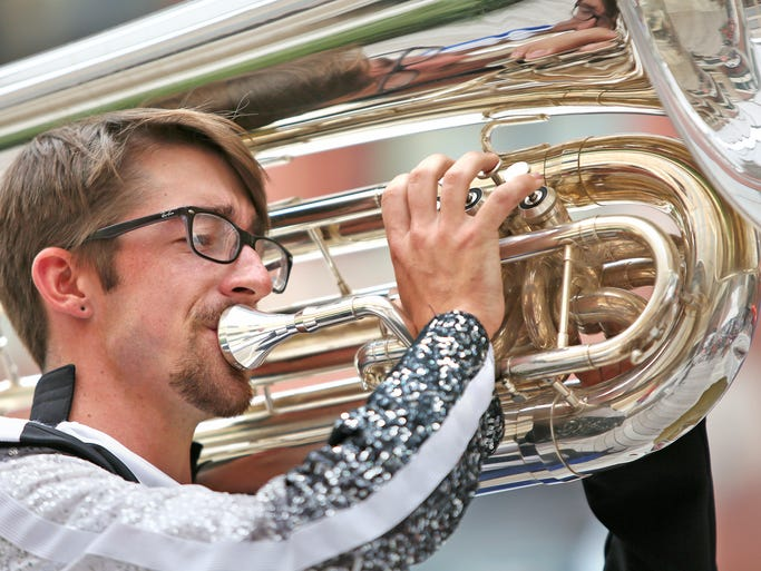 Ben Vasko, from El Paso, TX, performs on the tuba in the brass division competition during the DCI Performers Showcase, downtown, Wednesday, August 6, 2014. He usually plays with the Blue Devils Drum and Bugle Corps out of Concord, CA.
