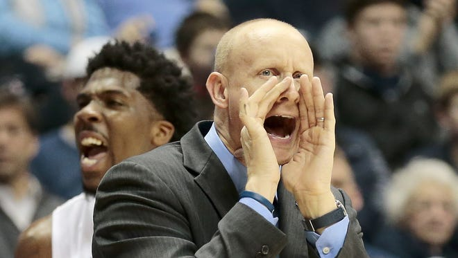 Xavier Musketeers head coach Chris Mack shouts to his team during the second half.