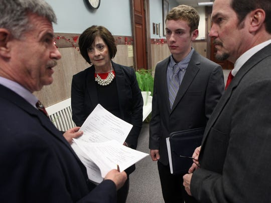 From left, Thomas F. Ferrarese, Democratic commissioner for the Monroe County Board of Elections, looks over petitions submitted in 2015 by Webster Village Board hopefuls Judy Gurnett and Evan Hoerner, a 17-year-old senior at Webster Schroeder High School. With them is Webster Mayor John Cahill.