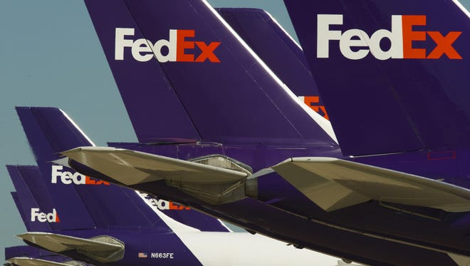 Federal Express cargo jets are lined up at the Memphis World Hub