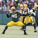 Green Bay Packers Datone Jones (95) celebrates his tip of a Cowboys field goal against the Dallas Cowboys.