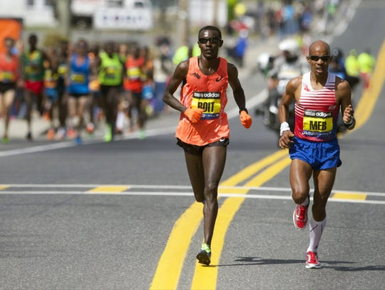Elite runners Josphat Boit, left, and Meb Keflezighi