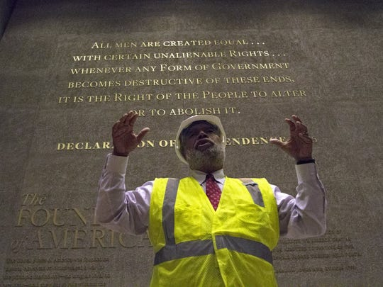 Museum Director Lonnie Bunch stands in-front of one