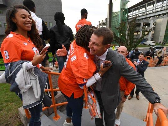 Clemson head coach Dabo Swinney is greeted by Clemson