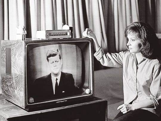 TV brought celebrities into the home. Even the homes of celebrities. Here, Gina Lollobrigida watchers President Kennedy on a television set in her Rome villa, July 23, 1962 during live telecast from the U.S. to Europe via the Telstar satellite.