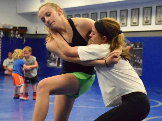 Brianna Reep, 13, left, and Jaylee Hatcher, 12, both of Stuarts Draft, work on Greco-Roman holds during practice with the Mat Pack Wrestling Club in the wrestling room at Washington & Lee University in Lexington, Va., on Wednesday, May 10, 2017.