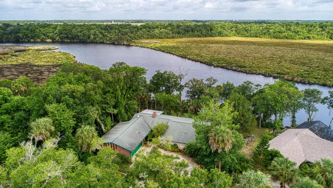 This four-bedroom, three-bath home sits on a large tranquil lot on the Tomoka River, offering amazing views, water access and tons of privacy.