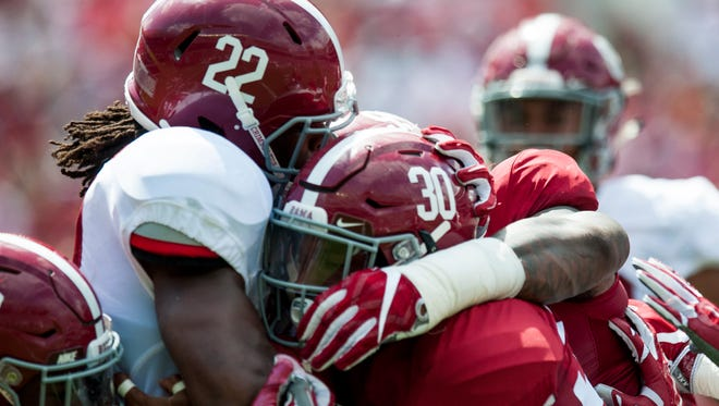 Alabama linebacker Mack Wilson (30) stops Alabama running back Najee Harris (22) during the A-Day scrimmage game at Bryant Denny Stadium in Tuscaloosa, Ala., on Saturday April 22, 2017.