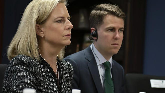 This photo from March 2018, provided by the Department of Homeland Security, shows then-Secretary of Homeland Security Kirstjen Nielsen and then-Department of Homeland Security chief of staff Miles Taylor. Taylor revealed that he wrote scathing commentary and a book about the Trump administration under the pen name Anonymous.