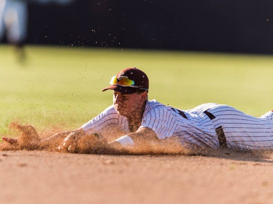 Breaux Bridge shortstop Keegan Cormier dives to make a play during a game last season.