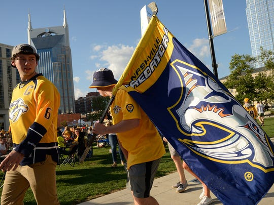 Nashville Predators fans watch the Stanley Cup Final on a giant screen at Walk of Fame Park in downtown Nashville on March 31, 2017 as game 2 against the Pittsburgh Penguins begins.