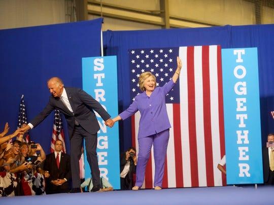 Hillary Clinton and Joe Biden acknowledge the crowd