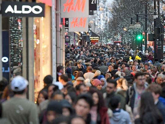 Shoppers crowd onto Oxford street on the last day of