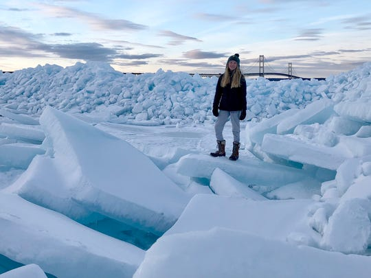 Janie McKee, 13, of Grosse Pointe Farms visited the the ice formations at the Straits of Mackinac on March 9, 2018 with her father Patrick McKee.