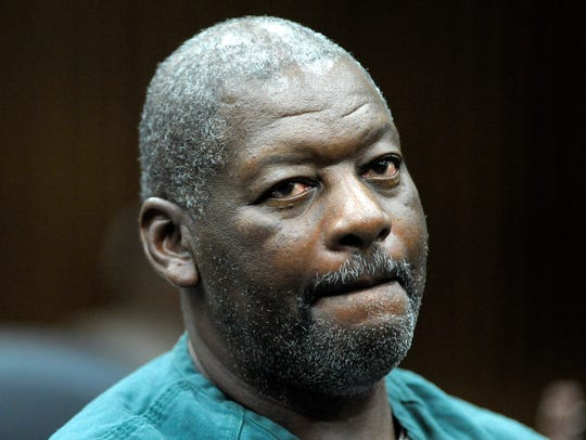 Charles Lewis listens to attorneys address the court