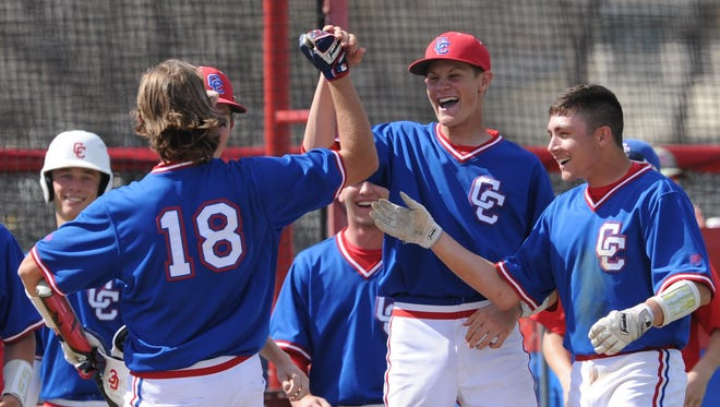 Cooper's Aidan Thompson and Andrew Benson, right, congratulate Jack Owens (18) after Owens' game-winning sacrifice fly in the seventh inning. The Cougars scored three runs in the seventh inning to beat Sweetwater 10-9 on the final day of the Abilene Invitational on Saturday, March 10, 2018 at Cougar Field.