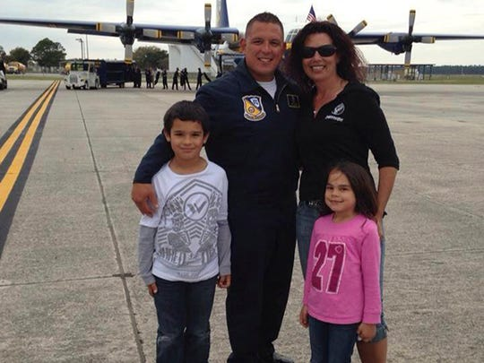 Gina Angel with her husband, Jason, and their children, Kimo and Kaelyn.