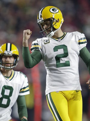Green Bay Packers' Mason Crosby reacts after kicking the extra point to tie the game 20-20.  .