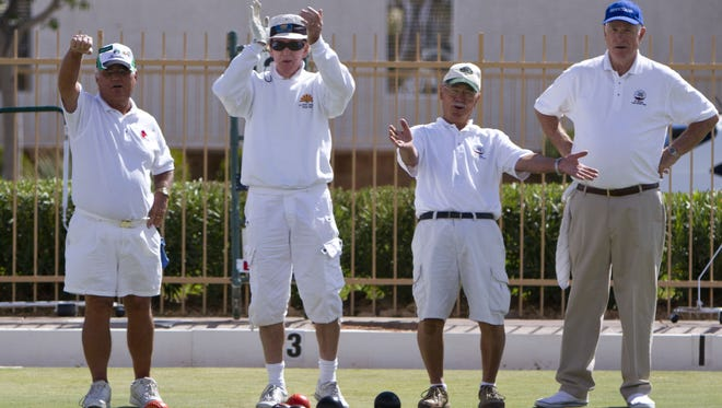 Jerry Knott, James Corr, Terry Eide and Richard Chamberlain react to a play during the Huntsman World Senior Games lawn bowls triples competition at SunRiver Lawn Bowls Greens, Oct. 6, 2011.  Samantha Clemens / The Spectrum