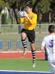 Wylie goalkeeper Cameron Dawsey (0) comes down after