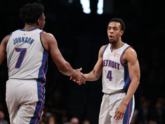Pistons guard Ish Smith, right, high-fives forward Stanley Johnson during the second quarter against the Nets.