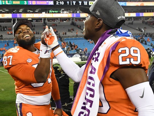 Clemson's D.J. Greenlee, left, celebrates the Tigers' 2017 ACC Championship Game win against Miami with teammate Marcus Edmond.