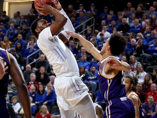 SDSU's Tevin King #2 pulls up a shot over Kobe Webster