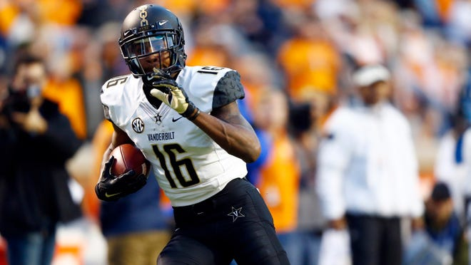 Vanderbilt wide receiver Kalija Lipscomb (16) runs for a touchdown in the first half of an NCAA college football game against Tennessee Saturday, Nov. 25, 2017, in Knoxville, Tenn. (AP Photo/Wade Payne)