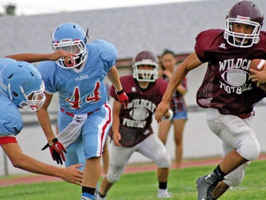 Cameron Sheppard evades an Anthony High School player Friday evening at Bob Cerny Stadium.