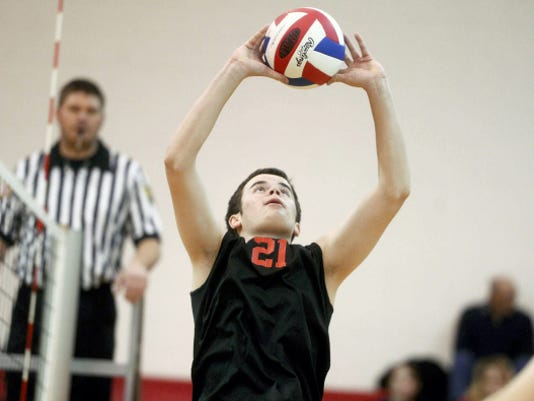 Susquehannock's Stephen Rouse sets during a boys' volleyball match at Susquehannock High School on March 31. Susquehannock beat Dover in three games.