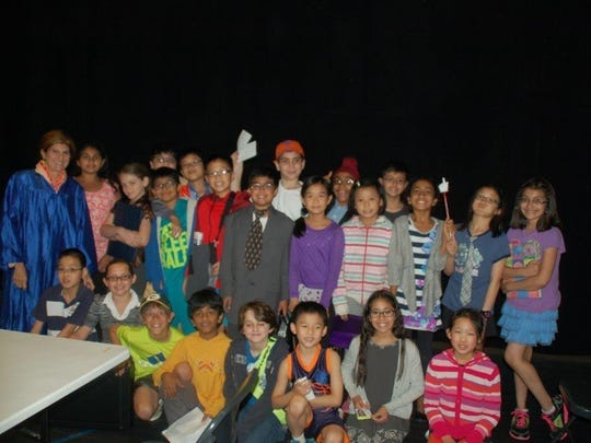 During the 2014-2015 school year, students at IEF Elementary School in Green Brook met once a week after school for a new mock trial team. The students were led by teachers Janice Belcuore and Maggie Silver. The students wrote their own original cases after diligently learning about the country's judicial system. Before the school year, the team presented their cases to their classmates and parents. Here team members are pictured with fourth-grade students at the school. This was a first-time venture in starting a mock trial team with the elementary students, andue to overwhelming response, it will be offered in the next school year, Belcuore said, with the goal of enter their cases into the New Jersey Bar Mock Trial competition.