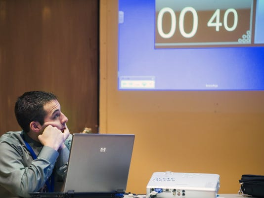 Chris Boyer watches the timer during the countdown round of Fifteenth Annual York County Invitational Mathcounts Competition at York College of Pennsylvania in 2012.
