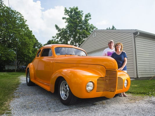 Bob and Linda Kuhn pose for a photo with their 1940 Chevy Coupe that they have been taking to the Street Rod Nationals at the York Expo Center. The Street Rod Nationals East will be held at the York Expo Center June 5, 6 and 7.