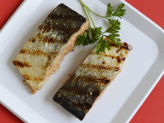 Grilled salmon is a great way to add more protein to your diet. DAILY RECORD/SUNDAY NEWS - KATE PENN
