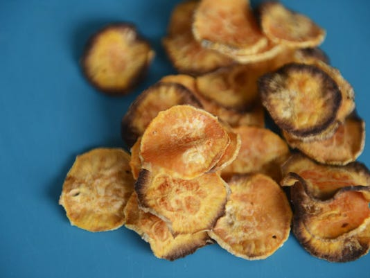 Baked potato chips are a healthy homemade snack. KATE PENN - DAILY RECORD/SUNDAY NEWS