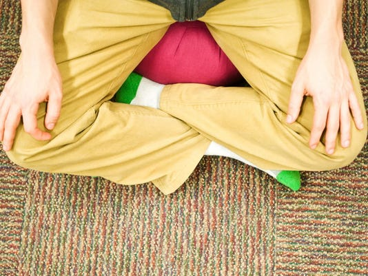 Feel the stress munchies taking over? Assume the yoga position! Clare Becker - The Evening Sun