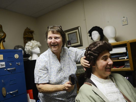 """Director Diane Crews jokes with another castmate as she brushes out Nick Quattrocchi's wig during dress rehearsal for """"The Legend of Sleepy Hollow"""" at DreamWrights Youth & Family Theatre Wednesday, October 2, 2013."""