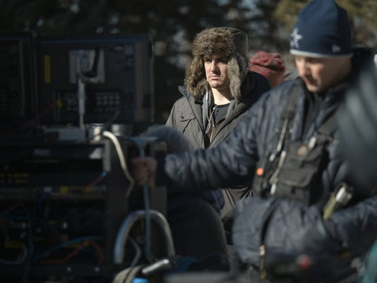 """Producer Neal Dodson stands at the monitor on set of his latest Golden Globe-nominated film """"A Most Violent Year."""""""