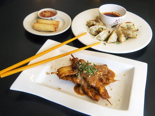 Market Street Viet Thai Cafe is one of the restaurants that will have food featured at the Flavors of York fundraiser on Sunday, Nov. 1, at The Yorktowne Hotel, 48 E. Market Street in York. The restaurant plans to serve chicken satay, foreground, vegetable egg rolls with sweet chili sauce, back left, and vegetable dumplings with ginger soy sauce, back right.