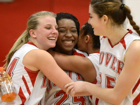 Dover's Alayah Hall is congratulated last year by teammates, from left, Maxine Herman, Ashentay Kearse and Megan Lokhaiser after passing 1,000 career points. She entered this week one point shy of the school record, and the Eagles are No. 1 in the first District 3 power ratings for Class AAAA. (GAMETIMEPA.COM -- FILE)