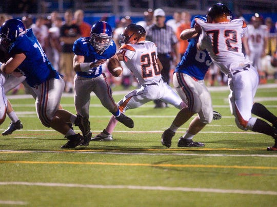 Spring Grove's Jeff Delaughter breaks free of Central York's Sherief Sutton during last year's YAIAA Division I football game in Spring Grove. (GAMETIMEPA.COM -- FILE)