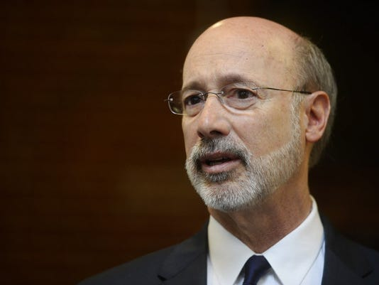 Despite Democratic opposition, Gov. Tom Wolf signed a bill closing a loophole that could allow harassment in labor disputes.