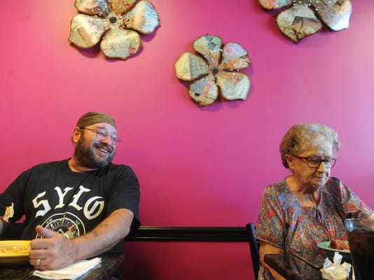 Ken Miranda, left, of McSherrystown, jokes with fellow patron Agnes Fabian of New Oxford during dinner at the Grand Eats and Sweets in Hanover on Friday, June 27, 2014.